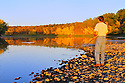 00416-031.11 Fishing: Angler is fishing from shore on Mississippi River during early fall.  Smallmouth, muskie, walleye, Minnesota.