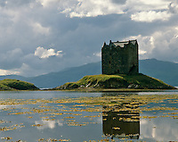 The imposing silhouette of Castle Stalker is situated on a rocky islet known as the Rock of the Cormorants at the mouth of Loch Linnhe on the west coast of Scotland