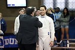 11 February 2017: UNC's Matt Shlimak (right) prepares for his Epee match. The Duke University Blue Devils hosted the University of North Carolina Tar Heels at Card Gym in Durham, North Carolina in a 2017 College Men's Fencing match. Duke won the dual match 19-8 overall, 6-3 Foil, 6-3 Epee, and 7-2 Saber.