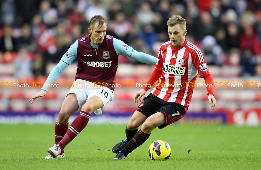 Sebastian Larsson of Sunderland and Jack Collison of West Ham - Sunderland vs West Ham United, Barclays Premier League at The Stadium of Light, Sunderland - 12/01/13 - MANDATORY CREDIT: Rob Newell/TGSPHOTO - Self billing applies where appropriate - 0845 094 6026 - contact@tgsphoto.co.uk - NO UNPAID USE.
