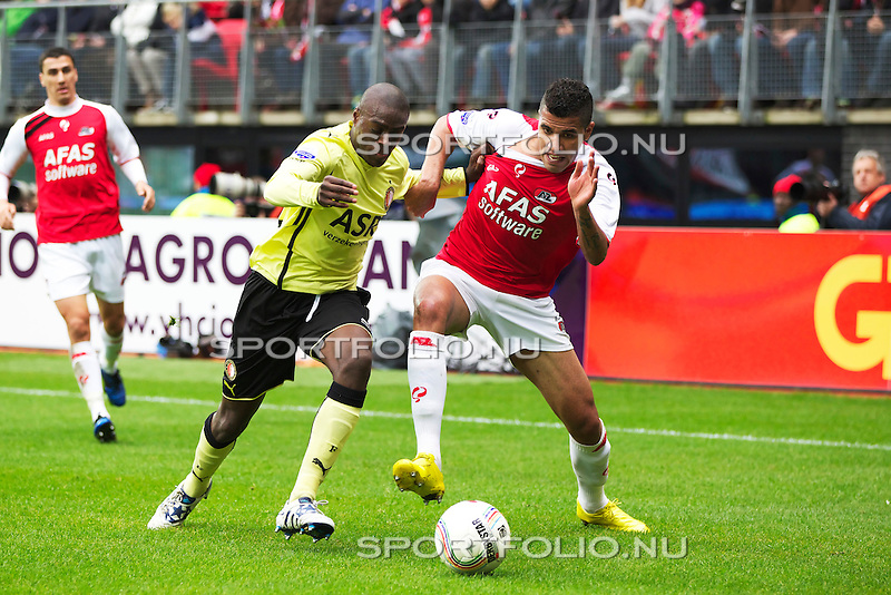 Nederland, Alkmaar,31 oktober 2010.Eredivisie.Seizoen 2010-2011.AZ-Feyenoord (2-0).Bruno Martins Indi van Feyenoord in duel om de bal met Jonathas van AZ