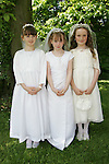 Hannah Doherty, Karen Reilly and Isabelle Scanlon at Sandpit First Communion on Saturday.