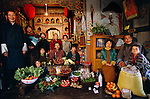 (MODEL RELEASED IMAGE). In Shingkhey, a remote hillside village of a dozen homes, Nalim and Namgay's family assembles in the prayer room of their three-story rammed-earth house with one week's worth of food for their extended family of thirteen. The Namgay family is one of the thirty families featured in the book Hungry Planet: What the World Eats (p. 36).