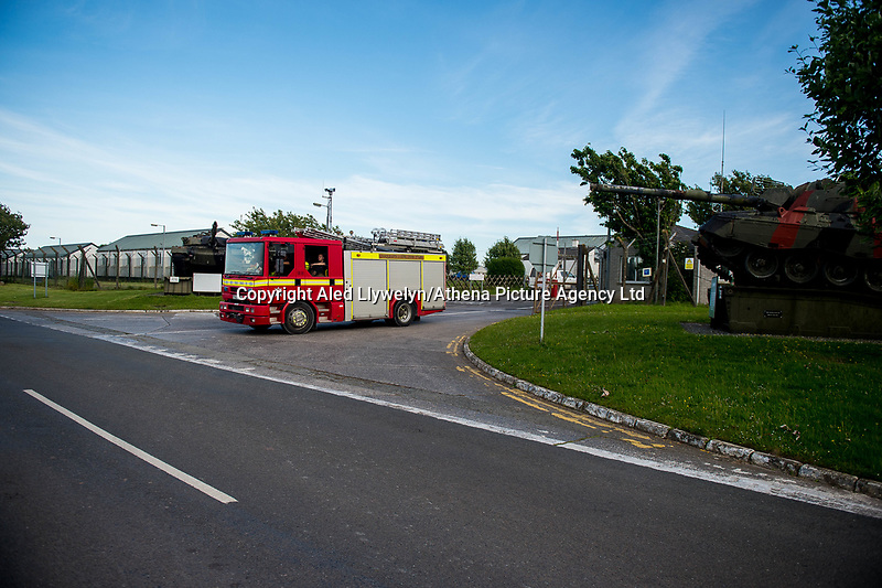 """Wednesday 14 June 2017<br /> Pictured: Emergency Services leave the training base <br /> Re: Paramedics and a fire crews are in attendance at what has been describes as an """"ongoing incident"""" at a military training base in Pembrokeshire.<br /> The Welsh Ambulance Service said it was alerted to an incident at the Castlemartin firing range just before 15:30 BST on Wednesday.<br /> The range is owned by the Ministry of Defence (MOD) Live firing was due to take place at the range from Monday to Friday.<br /> Mid and West Wales Fire and Rescue Service is also in attendance.<br /> Castlemartin is the only UK Army range normally available for direct-fire live gunnery exercises and is used by Army, Army reserves and cadets.<br /> It is also used by civilian organisations and research establishments."""