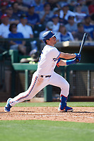 Nick Solak (15) of the Texas Rangers follows through on his swing during a Cactus League Spring Training game against the Los Angeles Dodgers on March 8, 2020 at Surprise Stadium in Surprise, Arizona. Rangers defeated the Dodgers 9-8. (Tracy Proffitt/Four Seam Images)
