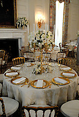 Washington, D.C. - May 7, 2007 -- Place settings in the State Dining Room for the State Dinner honoring Her Majesty Queen Elizabeth II and His Royal Highness The Prince Philip, Duke of Edinburgh of Great Britain in the White House in Washington, D.C. on Monday, May 7, 2007.  .Credit: Ron Sachs / CNP