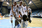 17 November 2015: North Carolina's Destinee Walker (24) is helped up by Stephanie Watts (5), Hillary Summers (30), and N'Dea Bryant (22). The University of North Carolina Tar Heels hosted the Florida A&M University Rattlers at Carmichael Arena in Chapel Hill, North Carolina in a 2015-16 NCAA Division I Women's Basketball game. UNC won the game 94-58.