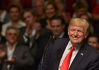 MIAMI, FL - JUNE 16: U.S. President Donald Trump speak to a crowd of people and sign an executive order policy changes toward Cuba at the Manuel Artime Theater in the Little Havana neighborhood on June 16, 2017 in Miami, Florida. The President will re-institute some of the restrictions on travel to Cuba and U.S. business dealings with entities tied to the Cuban military and intelligence services. Credit: MPI10 / MediaPunch