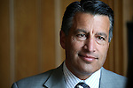 Nevada Gov. Brian Sandoval answers media questions at the historic Fourth Ward School in Virginia City, Nev., on Monday, April 13, 2015.<br /> Photo by Cathleen Allison