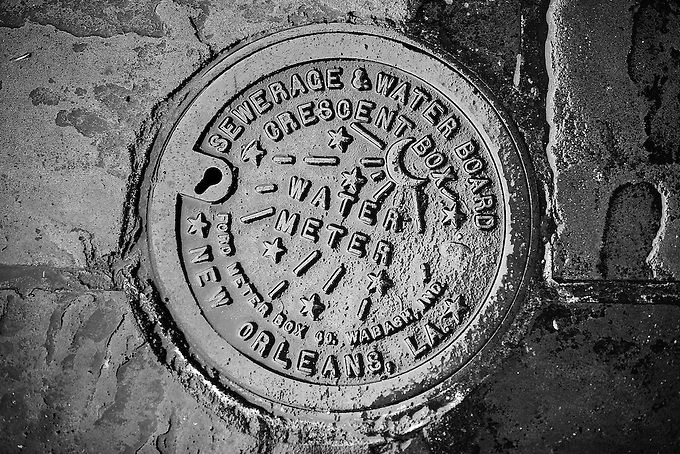 The unique'moon and stars' design of a New Orleans water meter.