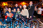 Lauren Keane, Mya McCool, Armel Whyte Molly Whyte, Claire Harte, Grace Harte (winner of the bike) with Major Jimmy Moloney, pictured at the turning on of the Christmas lights in Listowel on Saturday last.