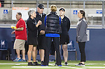 Costa Mesa, CA 02/20/16 - The referee crew and head coaches Lindsey Munday and Kerstin Kimel meet before the start of the game.