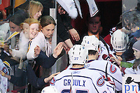 April 28, 2007; Hamilton, ON, CAN; Hamilton Bulldogs fans congratulate Bulldogs players as they leave the ice following their 6-2 win over the Rochester Americans in game six of the AHL north division semifinal at Copps Coliseum. With the win the Bulldogs eliminated the Americans from the playoffs. Mandatory Credit: Ron Scheffler, Special to the Spectator. (File number RRSA8598).