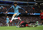 Leroy Sane of Manchester City jumps over Antonio Valencia of Manchester United during the English Premier League match at The Etihad Stadium, Manchester. Picture date: April 27th, 2016. Photo credit should read: Lynne Cameron/Sportimage