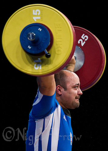 11 DEC 2011 - LONDON, GBR - Ferenc Gyurkovics (HUN) lifts during the men's +105kg category Snatch of the London International Weightlifting Invitational and 2012 Olympic Games test event held at the ExCel Exhibition Centre in London, Great Britain .(PHOTO (C) NIGEL FARROW)