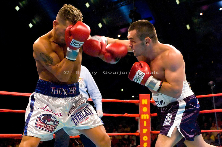 Leonard Dorin (right) connects against his opponent Arturo Gatti  during the WBC Super Lightweight Championship at the Boardwalk Hall in Atlantic City, New Jersey on July 24, 2004. Gatti won the fight by KO in the 2nd Round with a left body shot to the body. Photo by Thierry Gourjon.