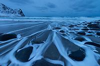 Winter tide flows over rocks at Unstad beach, Vestvågøy, Lofoten Islands, Norway