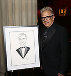 Ken Fallin with his drawing of Marc Rey attends 2017 Dramatists Guild Foundation Gala reception at Gotham Hall on November 6, 2017 in New York City.