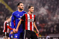 Cardiff City's defender Sean Morrison (4)  with Sheffield United's midfielder Chris Basham (6) during the Sky Bet Championship match between Sheff United and Cardiff City at Bramall Lane, Sheffield, England on 2 April 2018. Photo by Stephen Buckley / PRiME Media Images.