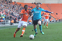 Blackpool's Nathan Delfouneso battles with Fleetwood Town's Gethin Jones<br /> <br /> Photographer Mick Walker/CameraSport<br /> <br /> The EFL Sky Bet League One - Blackpool v Fleetwood Town - Saturday 14th April 2018 - Bloomfield Road - Blackpool<br /> <br /> World Copyright &copy; 2018 CameraSport. All rights reserved. 43 Linden Ave. Countesthorpe. Leicester. England. LE8 5PG - Tel: +44 (0) 116 277 4147 - admin@camerasport.com - www.camerasport.com