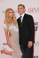 05 May 2017 - Beverly Hills, California - Paris Hilton, Chris Zylka. 24th Annual Race to Erase MS Gala held at Beverly Hilton Hotel in Beverly Hills. Photo Credit: Birdie Thompson/AdMedia