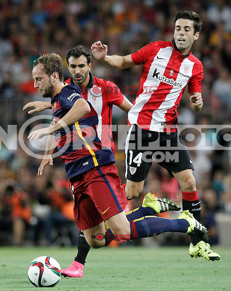 FC Barcelona's Ivan Rakitic (l) and Athletic de Bilbao's Markel Susaeta (r) and Mikel Balenziaga during Supercup of Spain 2nd match.August 17,2015. (ALTERPHOTOS/Acero)