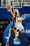 19 MAR 2011:  Forward Anders Halvorsen (30) of St. Thomas dunks over Mike Evans (42) of College of Wooster during the Division III Men's Basketball Championship held at the Salem Civic Center in Salem, VA. The University of St. Thomas (Minnesota) defeated College of Wooster 78-54 to win the national title.  Andres Alonso/NCAA Photos