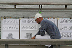 Artist selling his drawings on Pont Solferino, Paris, France.