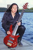 WANTAGH NY - AUGUST 09: John Myung of Dream Theater poses for a portrait at The Jones Beach Amphitheater on August 9, 1998 in Wantagh, New York. Photo by Larry Marano © 1998