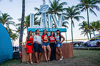 MIAMI, FL - FEBRUARY 2: Fans pose for picture in a decorations as they arrive to watch at the beach the Super Bowl XLIV Live on February 2, 2020 in Miami, USA. (Photo by Kena Betancur/VIEWpress/Getty Images)