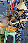 Woman Cooking On Sidewalk