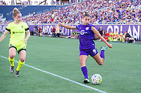 Orlando, Florida - Sunday, May 8, 2016: Orlando Pride defender Stephanie Catley (7) crosses the ball by Seattle Reign FC midfielder Kim Little (8) during a National Women's Soccer League match between Orlando Pride and Seattle Reign FC at Camping World Stadium.