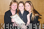 OVERJOYED: Siobhan and Sharon Twomey from Ballymacelligott were overjoyed as Aileen Twomey was presented with her certificate at the Handball Awards night at Ballyroe Heights Hotel, Tralee, on Friday..