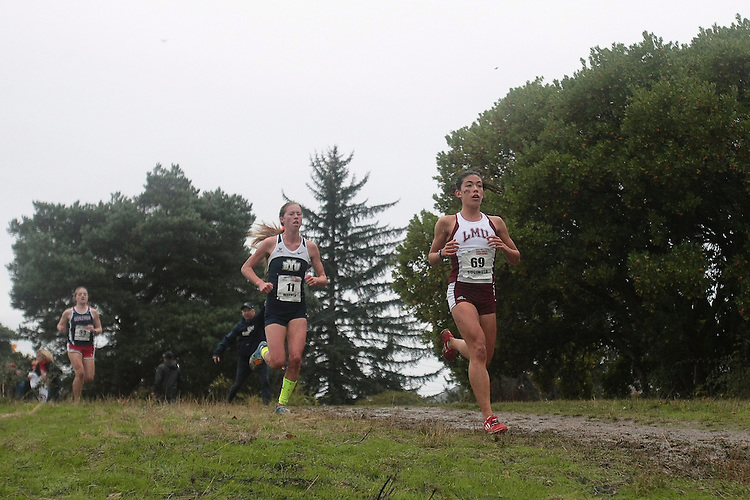 October 27, 2012; Portland, OR, USA; BYU Cougars runner Ashleigh Warner (11) , Loyola Marymount Lions runner Kelli Sugimoto (69) during the WCC Cross Country Championships at Fernhill Park.