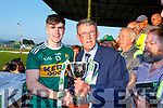 Kerry captain accepts the Munster U20 Football Cup from Liam Lenihan of the Munster Council in Austin Stack Park on Friday.