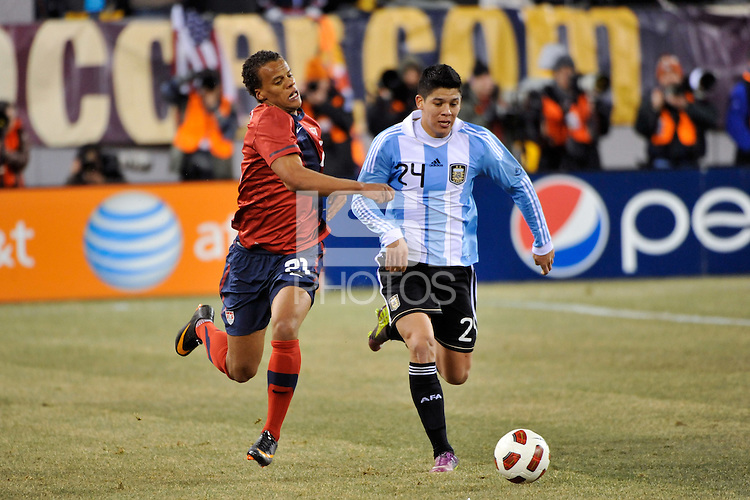 Timothy Chandler (21) of the United States and Marcos Rojo (24) of Argentina. The United States (USA) and Argentina (ARG) played to a 1-1 tie during an international friendly at the New Meadowlands Stadium in East Rutherford, NJ, on March 26, 2011.