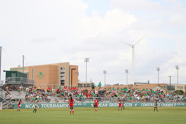Denton, TX - AUGUST 31:A general view of the field with players and the windmills during the game between the  University of North Texas Mean Green women's soccer and the University of Houston Cougars at the Mean Green Village Soccer Field on August 31, 2012 in Denton, Texas. NT won 2-1.(Photo by Rick Yeatts)