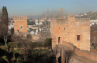 The Tower of the Princesses or Torre de las Infantas (right), a small palace, and the Judge's Tower or Torre del Cadi (left), on the ramparts of the Alhambra Palace, Granada, Andalusia, Southern Spain. Behind is El Albayzin, the medieval Moorish old town of Granada. The Alhambra was begun in the 11th century as a castle, and in the 13th and 14th centuries served as the royal palace of the Nasrid sultans. The huge complex contains the Alcazaba, Nasrid palaces, gardens and Generalife. Picture by Manuel Cohen