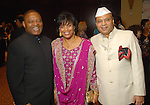 From left: Kase and Eileen Lawal with Raj Vats at the Indian Film Festival Celebrity Gala at the InterContinental Hotel Saturday evening Sept. 26,2009. (Dave Rossman/For the Chronicle)