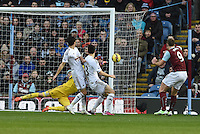 Burnley v Swansea <br /> Swansea's keeper Lukasz Fabianski pushes the ball around the post from Burnleys Sam Vokes shot