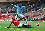 Aaron Wan-Bissaka of Manchester United challenges Raheem Sterling of Manchester City during the Premier League match at Old Trafford, Manchester. Picture date: 8th March 2020. Picture credit should read: Darren Staples/Sportimage