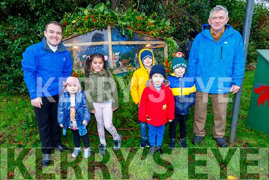 Fr Sean Jones, Emily Fennar, Ava Byrne, Bradley McCormack Hill and Joe Moynihan at the lighting of the Crib in Manor Village on Sunday.