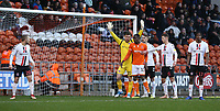 Blackpool's Joe Dodoo closely marked by (L to R) Charlton Athletic's goalkeeper Jed Steer, Patrick Bauer and Toby Stevenson as they wait for a corner kick<br /> <br /> Photographer Stephen White/CameraSport<br /> <br /> The EFL Sky Bet League One - Blackpool v Charlton Athletic - Saturday 8th December 2018 - Bloomfield Road - Blackpool<br /> <br /> World Copyright &copy; 2018 CameraSport. All rights reserved. 43 Linden Ave. Countesthorpe. Leicester. England. LE8 5PG - Tel: +44 (0) 116 277 4147 - admin@camerasport.com - www.camerasport.com