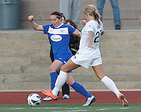 Boston Breakers defender Rhian Wilkinson (7) dribbles in the corner as Washington Spirit forward Stephanie Ochs (22) defends. In a National Women's Soccer League Elite (NWSL) match, the Boston Breakers (blue) tied the Washington Spirit (white), 1-1, at Dilboy Stadium on April 14, 2012.