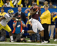 Marcus Davis of Virginia Tech catches the ball during Sugar Bowl game at Mercedes-Benz SuperDome in New Orleans, Louisiana on January 3rd, 2012.  Michigan defeated Virginia Tech, 23-20 in first overtime.