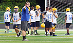 SEYMOUR CT. 15 August 2017-081517SV04-Seymour High School head football coach, Tom Lennon, runs his players through drills during football practice at the school in Seymour Tuesday.<br /> Steven Valenti Republican-American