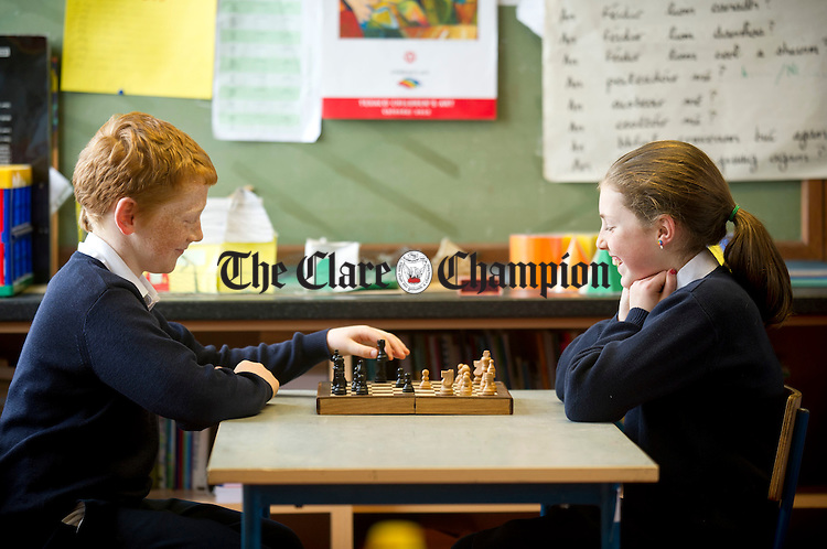 Sean Keane and Rachel Moloney battle it out on the chess board at New Quay National School. Photograph by Declan Monaghan