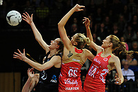 From left, Katrina Grant, Jo Harten and Helen Housby go up for the ball during the Taini Jamieson Trophy Series netball match between the New Zealand Silver Ferns and England Roses at Claudelands Arena in Hamilton, New Zealand on Wednesday, 13 September 2017. Photo: Dave Lintott / lintottphoto.co.nz