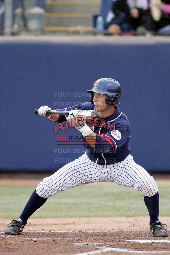 Jared Deacon #31 of the Cal. St. Fullerton Titans bunts against the Cal. St. Long Beach 49'ers at Goodwin Field in Fullerton,California on May 14, 2011. Photo by Larry Goren/Four Seam Images