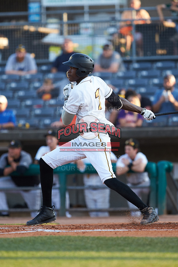 Oneil Cruz (7) of the West Virginia Power follows through on his swing against the Lexington Legends at Appalachian Power Park on June 7, 2018 in Charleston, West Virginia. The Power defeated the Legends 5-1. (Brian Westerholt/Four Seam Images)